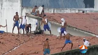 This grab from TV Ponta Negra shows inmates throwing objects from the prison roof during a riot.