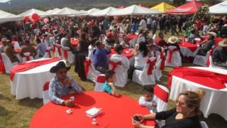 People sit at tables at Rubi's birthday party in La Joya, Mexico. Photo: 26 December 2016