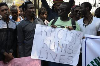 Members of the African Students Association hold placards during a protest in Hyderabad on February 6, 2016