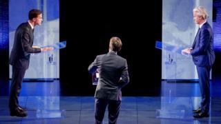 Mark Rutte (left) and his main rival Geert Wilders (right) met in the debate