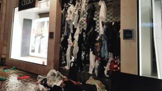 Torn-up clothes abandoned on Celio's roller shutter grilles