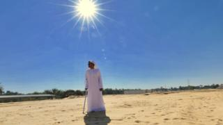 Emirati man standing in the desert sun