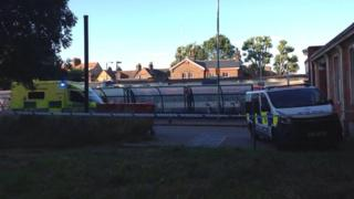 An ambulance and a police van at Wandsworth Common train station