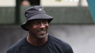 This file photo taken on June 14, 2015 shows US former basketball player Michael Jordan he attends the inauguration of a street basketball court in the Haies sports ground in Paris.