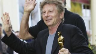 Roman Polanski with his Oscar in 2003