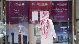 A man outside Qatar Airways office in Riyadh, Saudi Arabia