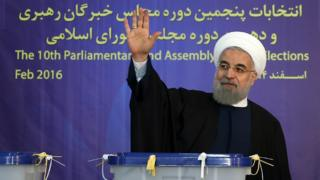 Iranian President Hassan Rouhani waves after voting in Tehran on 26 February 2016