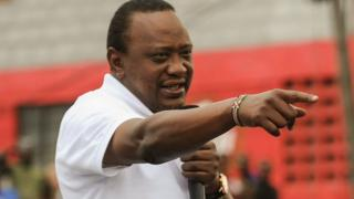 Kenya's President Uhuru Kenyatta addresses a crowd on September 1, 2017 in a Nairobi suburb