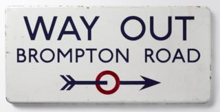 Johnston's Way Out sign for Brompton Road underground station