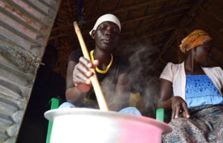A woman stirs porridge