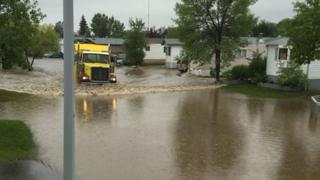 Emergency crews worked to drain flood waters after heavy rains in Fort McMurray in the Canadian province of Alberta.