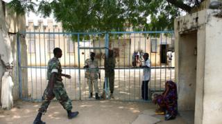Chadian police at the gates of a prison in the capital N'Djamena
