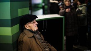 A man waits to receive his pension paid in Russian rouble notes in the eastern Ukrainian city of Donetsk on 1 April 2015.