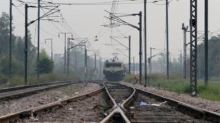 An Indian Railways passenger train travels on a railway track in New Delhi on November 10, 2015.