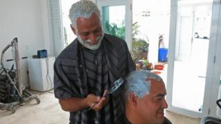 Two men who have dyed their hair blond in San Juan, Puerto Rico. Photo: 21 March 2017