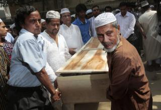 Bangladeshi Muslims carry the body of Xulhaz Mannan who was stabbed to death by unidentified assailants in Dhaka, Bangladesh, 26 April
