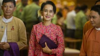 "Myanmar""s National League for Democracy (NLD) chairperson Aung San Suu Kyi (C) leaving after the new lower house parliamentary session in Naypyidaw"