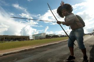 Brazilian indigenous person with a bow during a protest at Explanada dos Ministerios in Brasilia, Brazil, on 25 April 2017.