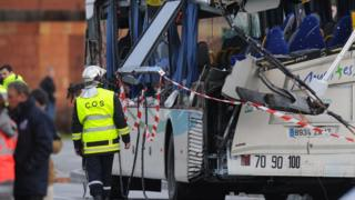 French police work respecting the wreckage  a school minibus after it crashed into a truck in Rochefort on February 11, 2016, killing at least six children