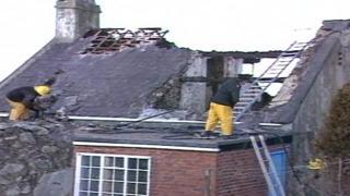 Firemen tackling a blaze at a holiday home