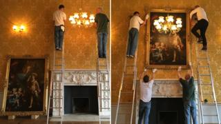 Portrait of Crew sisters being re-hung at Wrest Park