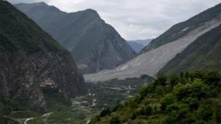 China landslide: More than 100 missing as search continues