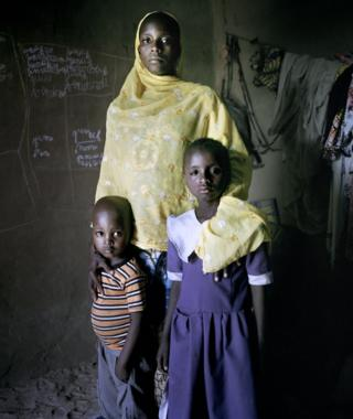 Aichadou, six, with her heavily pregnant mother Amina and four-year-old brother Ibrahim at an IDP camp for women and children, Mémé