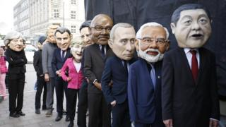 Protesters dressed like the G20 leaders return backstage from their appearance during a demonstration against the upcoming G20 economic summit during a protest march on July 2, 2017 in Hamburg, Germany