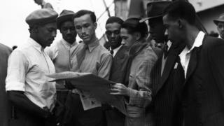 """Newly arrived Jamaican immigrants on board the """"Empire Windrush"""" at Tilbury."""