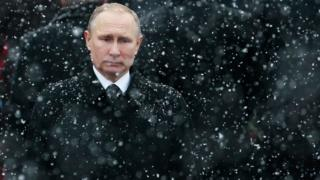 Russian President Vladimir Putin attends a wreath-laying ceremony at the Tomb of the Unknown Soldier in Moscow, Russia