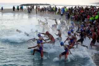 Participants rush into the water in the Mediterranean Sea as they take part in a triathlon in Ashkelon, Israel on June 16, 2017.