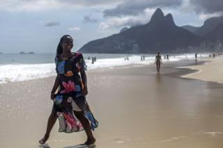 """Isabel Antonio, a 16-year-old singer and refugee from the Democratic Republic of Congo, poses for a portrait at Ipanema beach in Rio de Janeiro, Brazil on December 6, 2017. She lost her country and childhood in one of Africa""""s most terrible wars, but Congolese refugee Isabel Antonio has won the hearts of millions of Brazilians with her performances on The Voice Brasil."""