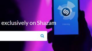 A screenshot showing the Shazam logo ad search bar