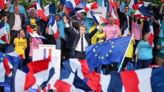 Mr Macron campaigning