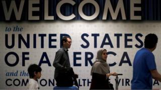 International passengers arrive at Washington Dulles International Airport on June 26, 2017