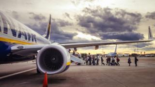 Passengers getting on flight at Edinburgh Airport