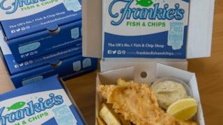 Fish and chips in boxes