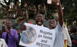 Zimbabweans celebrate after President Robert Mugabe resigns in Harare, Zimbabwe November 21 2017