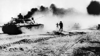 Iraqi troops riding in Soviet-made tanks trying to cross the Karun river. north-east of Khorramshahr in Iraq, during the Iran-Iraq war