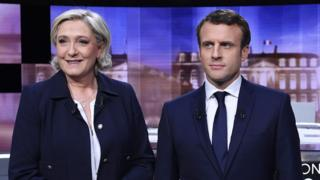 Emmanuel Macron (R) and Marine Le Pen on 3 May