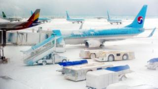 Planes and snow at Jeju International Airport