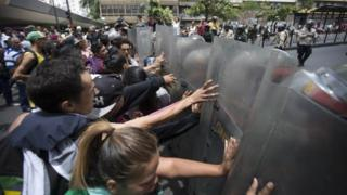 Protesters clash with police near the Miraflores presidential palace