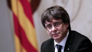 This photo shows Catalan president Carles Puigdemont attending a regional government meeting at the Generalitat Palace in Barcelona on October 10, 2017.