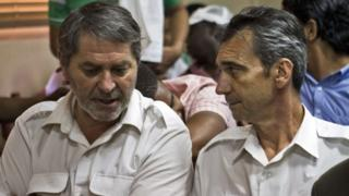 French pilots Pascal Fauret (left) and Bruno Odos attend a court hearing on 27 March 2013