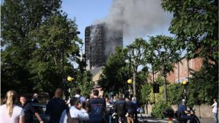 People look at the fire