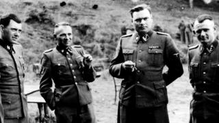 Josef Mengele pictured (left) with other senior Nazi officers