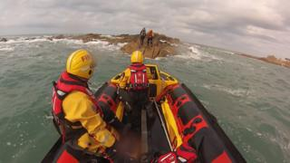 Woman rescued from rocks