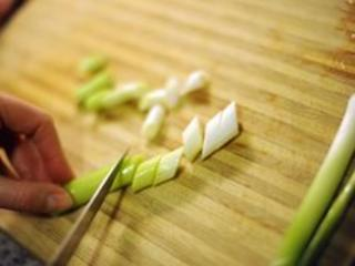 Spring onion being chopped, BBC