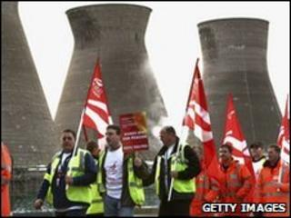 Workers at the Grangemouth oil refinery, waving flags and placards as they start their two day strike over a pension dispute on April 27, 2008
