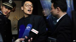 Ma Yaohai talks to the media before entering court in Nanjing, eastern China, 7 April